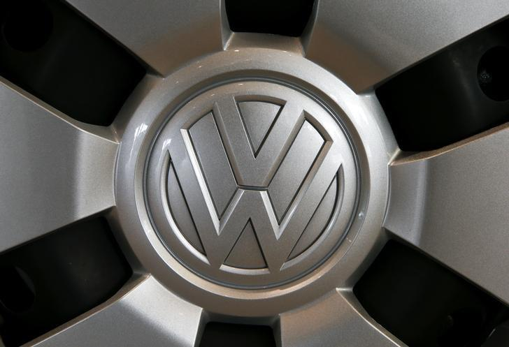 The logo of German carmaker Volkswagen is seen on a wheel at a showroom of Swiss car importer AMAG in Duebendorf, Switzerland February 12, 2016. REUTERS/Arnd Wiegmann
