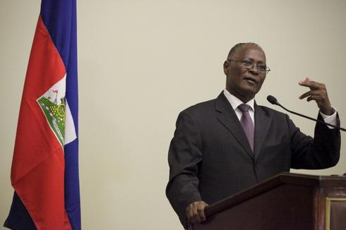 Haiti interim president appoints prime minister to help organize election