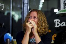 Tracy Bantleman, the wife of Canadian teacher Neil Bantleman, reacts during a news conference in Jakarta, Indonesia, February 26, 2016.  REUTERS/Darren Whiteside