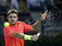 Stanislas Wawrinka of Switzerland returns the ball to Marcos Baghdatis of Cyprus during their final match at the ATP Dubai Duty Free Tennis Championships February 27, 2016. REUTERS/Ahmed Jadallah