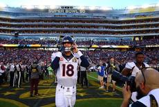 Feb 7, 2016; Santa Clara, CA, USA; Denver Broncos quarterback Peyton Manning (18) puts on his helmet before Super Bowl 50 against the Carolina Panthers at Levi's Stadium. Mandatory Credit: Mark J. Rebilas-USA TODAY Sports