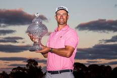 Feb 28, 2016; Palm Beach Gardens, FL, USA; Adam Scott celebrates with the trophy after winning the Honda Classic at PGA National. Mandatory Credit: Peter Casey-USA TODAY Sports