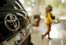 The logo of Toyota is seen on a Toyota Fortuner vehicle at a showroom in Jakarta, Indonesia February 24, 2016. Picture taken February 24.   REUTERS/Beawiharta
