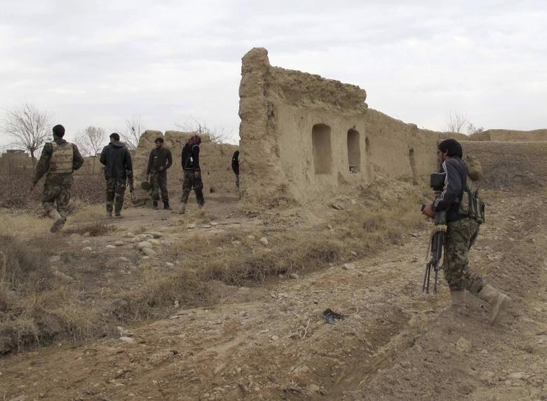 Afghan National Army (ANA) soldiers patrol at an outpost in Helmand province, Afghanistan December 25, 2015. REUTERS/Abdul Malik