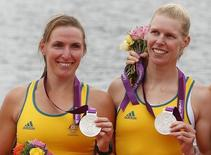 File photo of Kate Hornsey (L) and Sarah Tait standing during the victory ceremony after the women's pair finals at Eton Dorney during the London 2012 Olympic Games August 1, 2012.    REUTERS/Jim Young