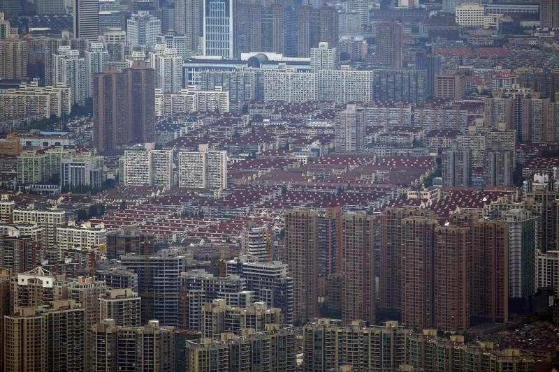 Forever blowing bubbles, Chinese investors pump Shanghai property