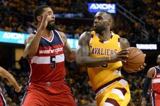 Mar 4, 2016; Cleveland, OH, USA; Cleveland Cavaliers forward LeBron James (23) drives on Washington Wizards forward Markieff Morris (5) during the third quarter at Quicken Loans Arena. Mandatory Credit: Ken Blaze-USA TODAY Sports