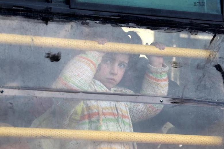 A Syrian girl rides a bus towards Turkey to the Bab Al-Salam border crossing, in Darat Izza, Aleppo countryside, Syria February 10, 2016. REUTERS/Ammar Abdullah