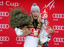Nov 29, 2015; Aspen, CO, USA; Mikaela Shiffrin of the United States celebrates on the podium after winning the women's slalom race at the FIS alpine skiing World Cup at Aspen Snowmass. Mandatory Credit: Jeff Swinger-USA TODAY Sports