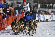 Travis Beals' team leaves the start chute at the restart of the Iditarod Trail Sled Dog Race in Willow, Alaska March 6, 2016.  REUTERS/Nathaniel Wilder