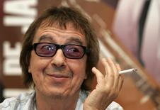 Former Rolling Stone Bill Wyman smokes during a news conference in Oviedo, in this file photograph dated July 20, 2006. Wyman has been diagnosed with prostate cancer, according to a statement from the rock band's press office. REUTERS/Stringer/files