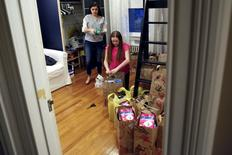 Emma Joy (L), 16, and her sister Quinn, 12, pack feminine products for delivery at their home in South Orange, New Jersey March 6, 2016.  REUTERS/Shannon Stapleton