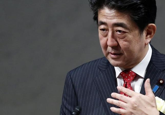 Japan's Prime Minister Shinzo Abe speaks during a year end meeting at Japan Business Federation (Keidanren) in Tokyo December 25, 2014. REUTERS/Yuya Shino (JAPAN - Tags: BUSINESS POLITICS) - RTR4J7RF