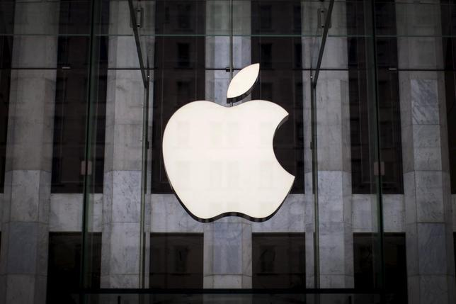An Apple logo hangs above the entrance to the Apple store on 5th Avenue in New York City, in this file photo taken July 21, 2015.     REUTERS/Mike Segar