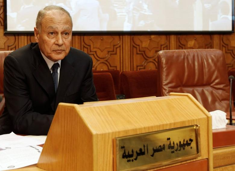 Ahmed Aboul Gheit sits beside an unoccupied seat for the Libyan foreign minister, at the opening of an emergency meeting among the Arab League foreign ministers, held to discuss issues about Libya, at the headquarters in Cairo  March 2, 2011.  REUTERS/Amr Abdallah Dalsh