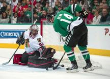 Mar 11, 2016; Dallas, TX, USA; Dallas Stars left wing Jamie Benn (14) scores a goal against Chicago Blackhawks goalie Corey Crawford (50) during the second period at American Airlines Center. Mandatory Credit: Jerome Miron-USA TODAY Sports