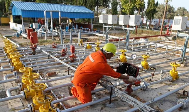 A technician works inside the Oil and Natural Gas Corp (ONGC) group gathering station on the outskirts of the western Indian city of Ahmedabad March 2, 2012. REUTERS/Amit Dave/Files