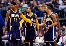 Mar 12, 2016; Dallas, TX, USA; Indiana Pacers forward Paul George (13) and guard Monta Ellis (11) and guard George Hill (3) react during the second half against the Dallas Mavericks at American Airlines Center. Mandatory Credit: Kevin Jairaj-USA TODAY Sports