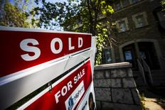 "A ""For Sale"" sign stands in front of a home that has been sold in Toronto, Canada, June 29, 2015. REUTERS/Mark Blinch"