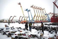 Buyers look over machinery at the Ritchie Brothers Auction in Nisku, Alberta on December 11, 2015.  REUTERS/Topher Seguin