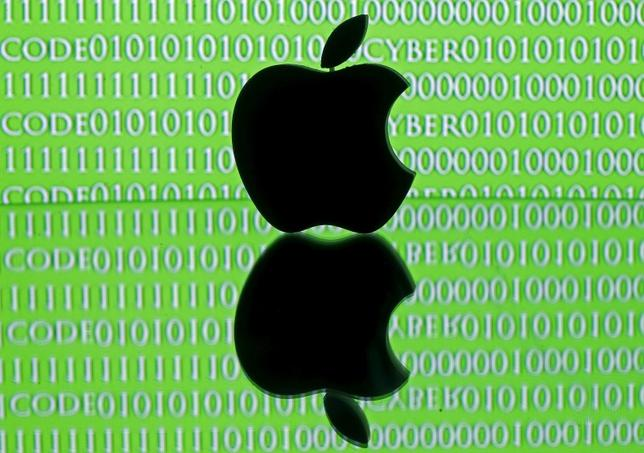 A 3D printed Apple logo is seen in front of a displayed cyber code in this illustration taken February 26, 2016. Apple Inc's stance on privacy in the face of a U.S. government demand to unlock an iPhone belonging to one of the San Bernardino attackers has raised awkward questions for the world's mobile network operators. REUTERS/Dado Ruvic/Illustration