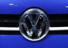 A Volkswagen (VW) logo is pictured on a car on the company's booth during the second media day of the 86th International Motor Show in Geneva, Switzerland, March 2, 2016.  REUTERS/Denis Balibouse