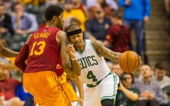 Boston Celtics guard Isaiah Thomas (4) dribbles the ball while Indiana Pacers forward Paul George (13) defends during the second half of  the game at Bankers Life Fieldhouse. Indiana Pacers defeat Boston Celtics 103-98. Mandatory Credit: Trevor Ruszkowski-USA TODAY Sports