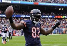 Chicago Bears tight end Martellus Bennett (83) celebrates after he catches a pass for a touchdown in the second quarter of the game against the Oakland Raiders at Soldier Field. Mandatory Credit: Matt Marton-USA TODAY Sports
