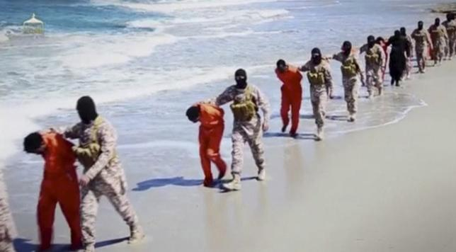 Islamic State militants lead what are said to be Ethiopian Christians along a beach in Wilayat Barqa, in this still image from an undated video made available on a social media website on April 19, 2015. REUTERS/Social Media Website via Reuters TV