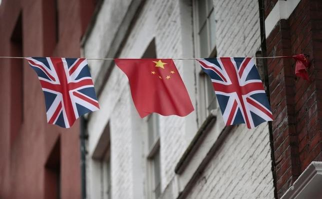 Chinese and British flags fly in London's Chinatown, Britain October 19, 2015. Chinese President Xi Jinping arrives in Britain on Monday for a state visit at the invitation of Queen Elizabeth II, the first state visit to the United Kingdom by a Chinese leader since 2005. REUTERS/Suzanne Plunkett - RTS544V