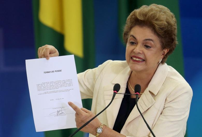 Brazil's President Dilma Rousseff shows a document confirming former president Luiz Inacio Lula da Silva's appointment as chief of staff, at Planalto palace in Brasilia, Brazil, March 17, 2016. REUTERS/Adriano Machado