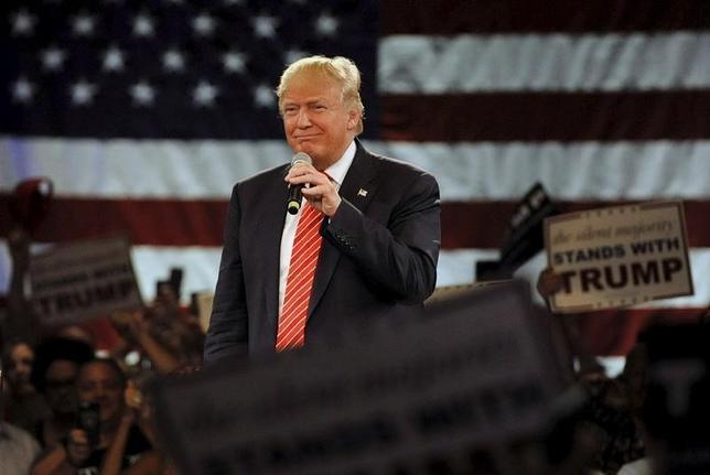 3月16日、なぜトランプ候補(写真)は米大統領選の共和党指名争いで勝利を収めつつあるのか。フロリダ州で14日撮影(2016年 ロイター/Steve Nesius)