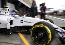 Formula One -  Australia Grand Prix - Melbourne, Australia - 18/03/16 - Williams F1 driver Valtteri Bottas leaves the team pits during the first practice session at the Australian Formula One Grand Prix in Melbourne.   REUTERS/Brandon Malone