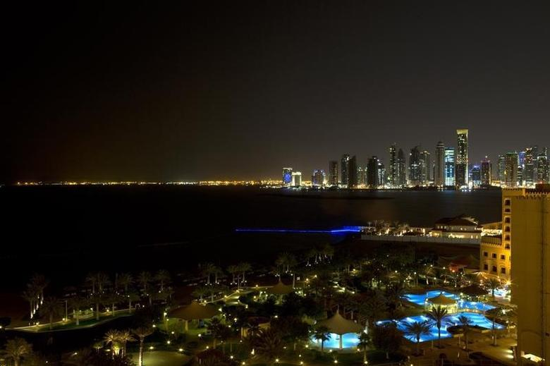 The skyline of Doha is seen at night March 5, 2013. REUTERS/Jacquelyn Martin/Pool