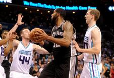 San Antonio Spurs forward center LaMarcus Aldridge (12) looks to shoot as he is defended by Charlotte Hornets forward center Frank Kaminsky (44) during the second half of the game at Time Warner Cable Arena. Hornets win 91-88. Mandatory Credit: Sam Sharpe-USA TODAY Sports