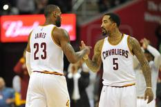 Cleveland Cavaliers forward LeBron James (23) celebrates with guard J.R. Smith (5) while leaving the game with a triple-double during the fourth quarter against the Denver Nuggets at Quicken Loans Arena. The Cavs won 124-91. Mandatory Credit: Ken Blaze-USA TODAY Sports