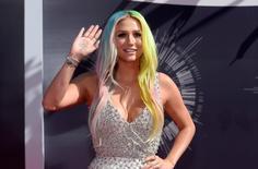 Kesha arrives at the 2014 MTV Music Video Awards in Inglewood, California, in this file photo taken August 24, 2014. REUTERS/Kevork Djansezian/Files