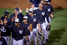 Mar 22, 2016; Tampa, FL, USA; The New York Yankees celebrate the win over the New York Mets at George M. Steinbrenner Field. The Yankees defeat the Mets 6-3. Mandatory Credit: Jerome Miron-USA TODAY Sports