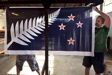 Factory workers Garth Price (R) and Andrew Smith hang new designs of the national flag of New Zealand at a factory in Auckland, New Zealand, in this November 24, 2015 file photo.   REUTERS/Rafael Ben-Ari/Files