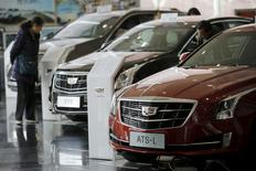 Visitors look around Cadillac cars at its dealership in Beijing, China, March 14, 2016. REUTERS/Kim Kyung-Hoon