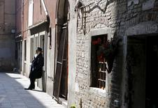 A Jewish man leans against a wall in the Venice ghetto, northern Italy, March 21, 2016. REUTERS/Alessandro Bianchi