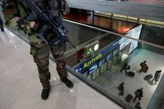 A French soldier patrols inside the Charles de Gaulle International Airport in Roissy, near Paris, France, March 23, 2016 as France has decided to deploy 1,600 additional police officers to bolster security at its borders and on public transport following the bomb attacks in Brussels.   REUTERS/Philippe Wojazer