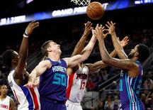 Mar 25, 2016; Auburn Hills, MI, USA; Charlotte Hornets forward Tyler Hansbrough (50) and guard Troy Daniels (R) battle for the ball with Detroit Pistons forward Marcus Morris (13) during the fourth quarter at The Palace of Auburn Hills. The Pistons won 112-105.  Raj Mehta-USA TODAY Sports