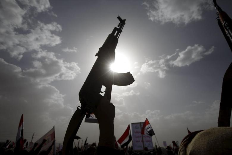 A Houthi follower rises a weapon as he attends a rally marking one year of Saudi-led air strikes, in Yemen's capital Sanaa, March 26, 2016. REUTERS/Mohamed al-Sayaghi