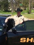 A deputy from the Pulaski County Sheriff's Office is seen in an undated photograph wearing one of the new cowboy hats that is topping off the uniform for the department located in and around the Arkansas capital of Little Rock.   REUTERS/Pulaski County Sheriff's Office/Handout via Reuters