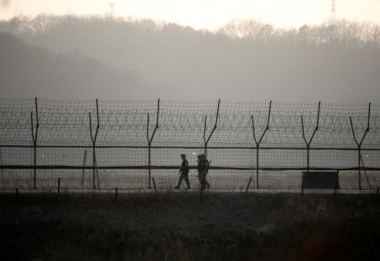 South Korean soldiers patrol along a barbed-wire fence at a guard post near the demilitarized zone separating the two Koreas in Paju, South Korea, March 21, 2016. REUTERS/Kim Hong-Ji