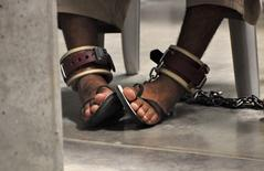 "In this photo, reviewed by a U.S. Department of Defense official, a Guantanamo detainee's feet are shackled to the floor as he attends a ""Life Skills"" class inside the Camp 6 high-security detention facility at Guantanamo Bay U.S. Naval Base in this file pool photo taken April 27, 2010. REUTERS/Michelle Shephard/Pool/Files"
