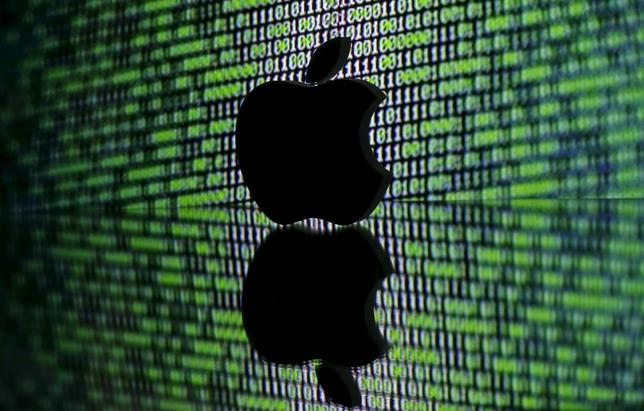 A 3D printed Apple logo is seen in front of a displayed cyber code in this illustration taken March 22, 2016. REUTERS/Dado Ruvic/Illustration