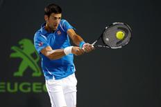 Mar 30, 2016; Key Biscayne, FL, USA; Novak Djokovic hits a backhand against Tomas Berdych (not pictured) on day ten of the Mami Open at Crandon Park Tennis Center. Geoff Burke-USA TODAY Sports