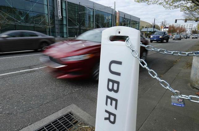 An Uber sign points to drop off and pick up location on a city street in Portland, Oregon March 19, 2016.   REUTERS/Mike Blake